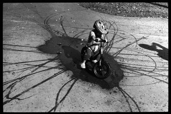 street-photography-scanning-film-benefits-Roll-17-Kid-on-Bike-in-Puddle-Tavis-Leaf-Glover-55